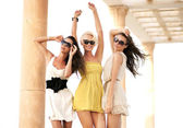 Three cheerful women wearing sunglasses — Stock Photo