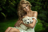 Cute young lady and a puppy dog — Stock Photo