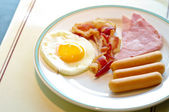 Breakfast, fried egg and sausage — Stock Photo