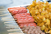Fried sausage with bamboo stick — Stockfoto