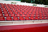 Red bleachers in areana — Stock Photo