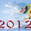 Dragon fly with 2012 year number - Stock Photo