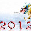Dragon fly with 2012 year number and sky background - Stock Photo