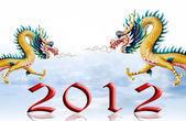 Dragon flying with 2012, Sky and glaze background — Stock Photo