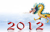 Dragon fly with 2012 year number and sky background — Stock Photo