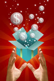 Money bubble flying out from green gift box in the hand — Stock Photo