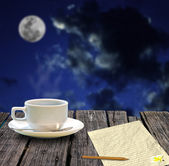 Hot coffee and letter paper for write mail with night sky — Stock Photo