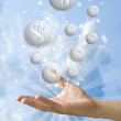 Money bubble flying from the hand with nice sky background — Stock Photo #7156478