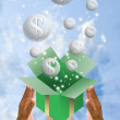 Money bubble flying from gift box with blue sky background — Stock Photo
