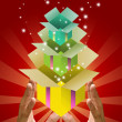 Colorful gift box inside gift box in the hand, — Stock Photo #7158893