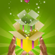 Magic box with gift box inside in hand — Stock Photo #7159193