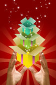 Colorful gift box inside gift box in the hand, — Stock Photo
