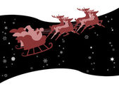 Santa Claus in his sleigh with snow — Stock Photo