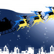 Santa Claus in his sleigh with snow over the city background — Stock Photo