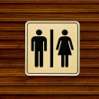 Toilet sign on wooden wall — Stock Photo