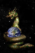 Dragon rolled the earth in the space area — Stockfoto