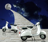 White retro scooter with stone way to the moon — Stock Photo