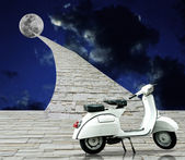 Retro scooter parking with road to the moon — Stock Photo