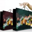 Girl hand pick up the green christmas shopping bag — Stock Photo