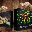 Lady hand pick up Shopping bag from wooden display — Stock Photo