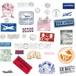 Vintage airmail labels and stamps - Stock Photo