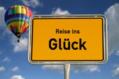 German road sign travel to happiness — Stock Photo