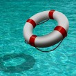 Life buoy on blue water — Stock Photo