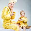 Daughter with her young mother making up — Stock Photo