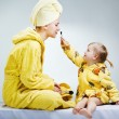 Stock Photo: Daughter and mother putting makeup