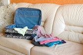 Collect suitcase in road — Stock Photo