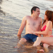 Couple sitting in water — Stock Photo