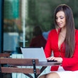 Businesswoman  in outdoors cafe - Stock Photo