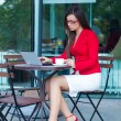 Businesswoman in outdoors cafe — Stock Photo #7065401