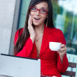 Businesswoman in outdoors cafe — Stock Photo #7065568