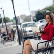 Businesswoman sitting on bench — Stock Photo