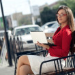 Businesswoman sitting on bench looking at camera — Stock Photo #7233422