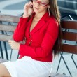 Businesswoman calling by phone outdoors — Stock Photo #7233526