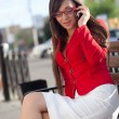 Businesswoman calling by phone, wearing red jacket — Stock Photo #7233528