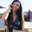 Smiling woman talking by phone — Stock Photo #7233766