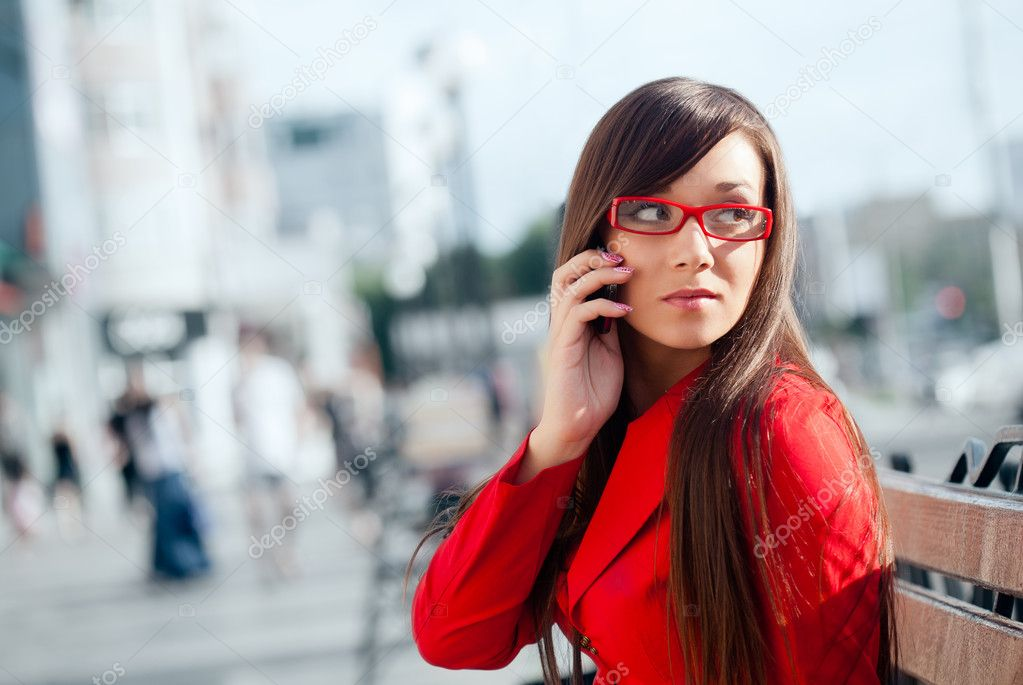 Serious businesswoman  calling by phone, wearing red glasses — Stock Photo #7233620