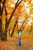 Woman walking in autmn park — Stock Photo