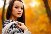 Closeup brunette in autmn park — Stock Photo