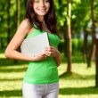 Brunette woman holding laptop - Stock Photo