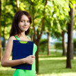 Brunette woman holding tablet - Stock Photo
