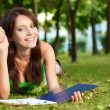 Student girl laying on grass — Stock Photo