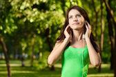 Brunette woman enjoy the music — Stock Photo