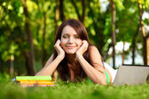Happy woman laying on grass — Stock Photo