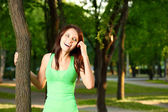 Woman in the evening summer park — Stock Photo