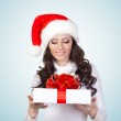 Woman looking st gift box — Stock Photo