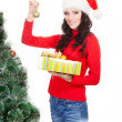 Woman holding toy for fur tree — Stock Photo #7791191